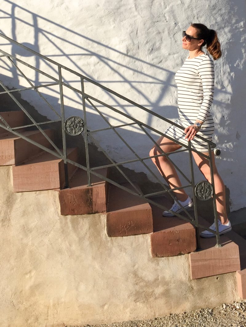 Striped dress on the stairs of the white tower