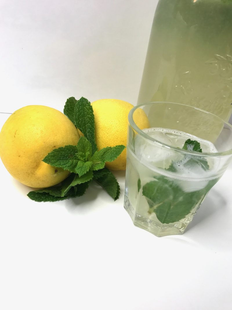 Glas of lemonade with lemon and mint
