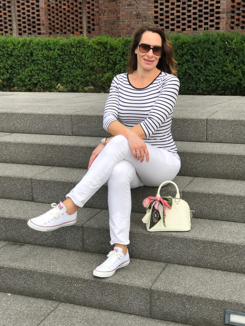 striped shirt and white trouser in a lifestyle-tale way