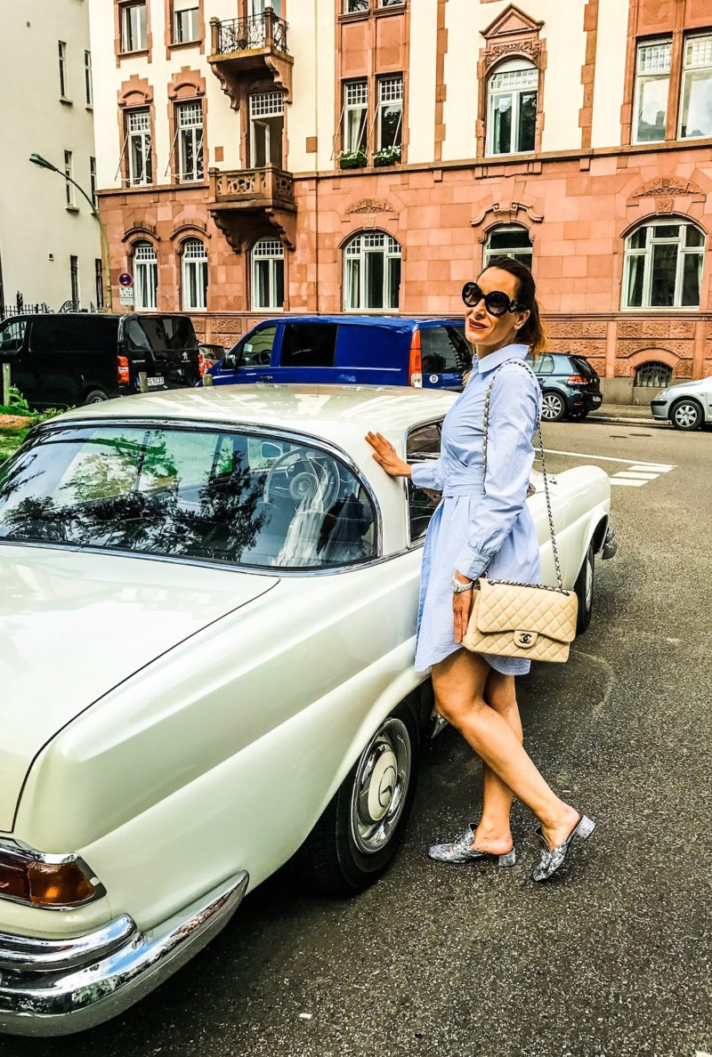 Blouse dress in blue and a dream car