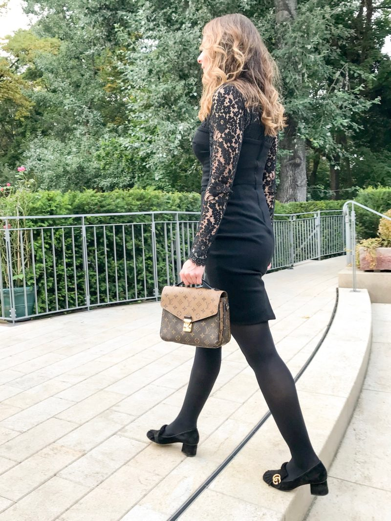 little black dress and louis vuitton bag