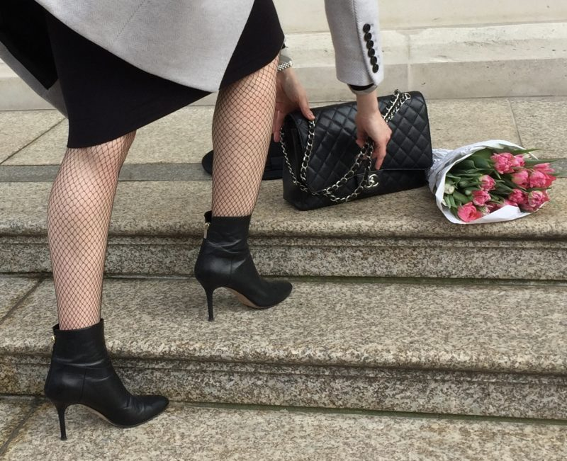 Fishnet stockings, skirt and ankle boots